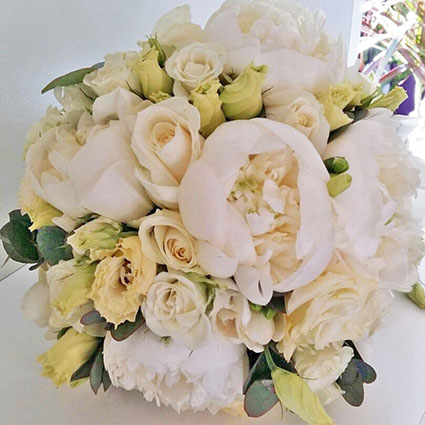 Flowers. Bridal bouquet of white peonies, roses and lisianthus.  A wedding is a special event and each bridal bouquet is
