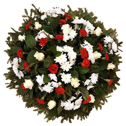 Flowers. Funeral wreath with white roses, red carnations, white chrysanthemums and decorative foliage. Wreath with a ribbon