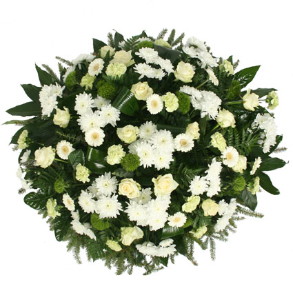 Funeral wreath with white roses, white gerberas, white chrysanthemums, green carnations and decorative foliage.