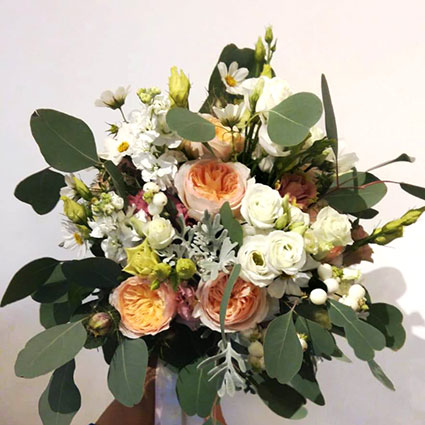 Flowers delivery. Bridal bouquet with luxurious David Austin roses.  A wedding is a special event and each bridal bouquet