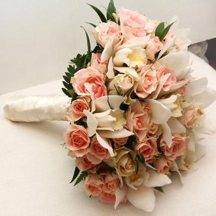 Flowers in Riga. Bridal bouquet of light pink spray roses and white orchids.  A wedding is a special event and each bridal