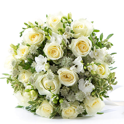 Flowers delivery. White roses, white freesias and decorative fine flowers in an elegant flower bouquet. The biggest flower