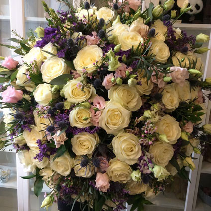 Flower delivery Latvia. Impressive bouquet of  white roses, pink lisianthus and blue decorative flowers.