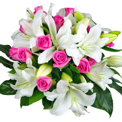 Ziedi un to piegāde. Grezns ziedu pušķis no baltām lilijām ar rozā rožu akcentiem.  Ziedu klāsts ir ļoti plašs. Var