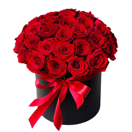 Flowers delivery. Arrangement of 35 red roses in a flower box - the essence of elegance, romance and passion.