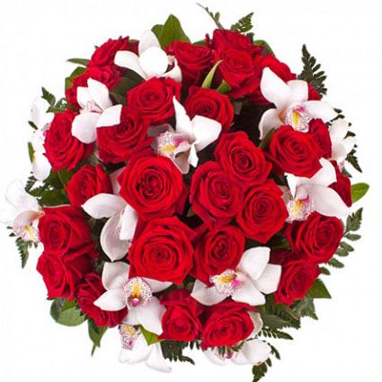 Ziedi ar piegādi. Lielisks pušķis no 29 sarkanām rozēm un baltu orhideju ziediem.   Ziedu klāsts ir ļoti plašs. Var