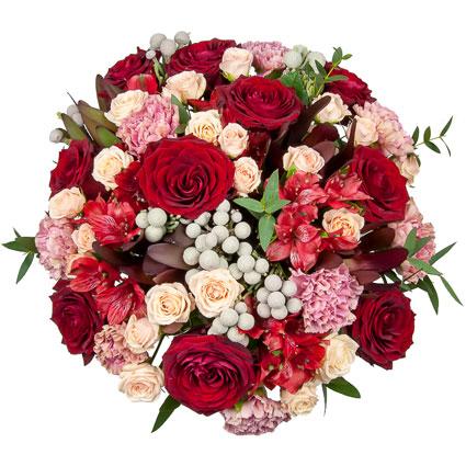 Ziedu piegāde - jauktu ziedu pušķī izmantoti tradicionālie Ziemasssvētku krāsu akcenti prieka un svētku noskaņas radīšanai.