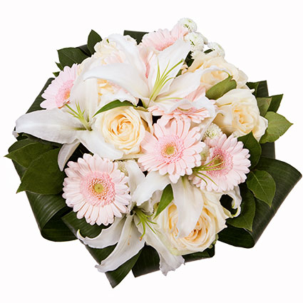 Flowers. Bunch of flowers in soft shades of white roses, white lilies, pink gerberas and decorative foliage.