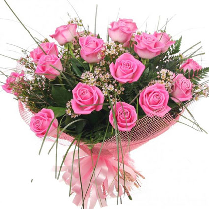 Flowers on-line. Bouquet of 17 pink roses and decorative foliage. Rose stem length 50 cm.