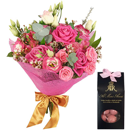 Flowers in Riga. Pink bouquet of roses and lisianthus with decorative foliage andAL MARI ANNI chocolate dragees
