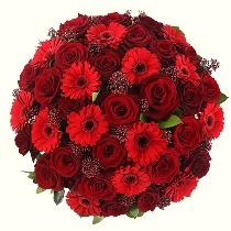 Ziedu pušķis no sarkanām rozēm un gerberām. Piegāde Rīgā